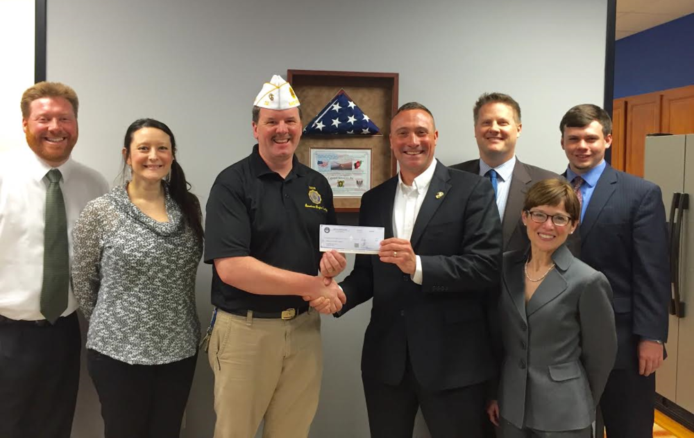 Capitol Services staff pictured with Mark Sutton, Public Relations Director at the American Legion Department of Michigan. Capitol Services awarded the Michigan American Legion Foundation a gift in support of the Heroes to Hometowns program.