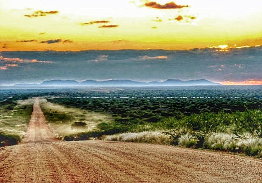 Red dust hovers over a road in the remote Otjozondjupa Region, Namibia.