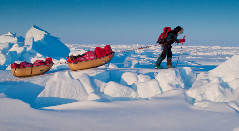 John Huston hauling 300 pounds on the way to the North Pole. @ John Huston