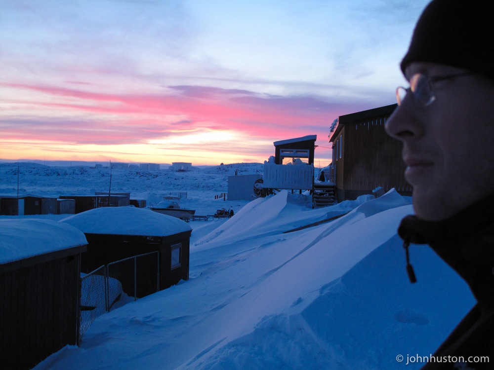 Tyler and the Arctic sunset over the Frobisher Bay.