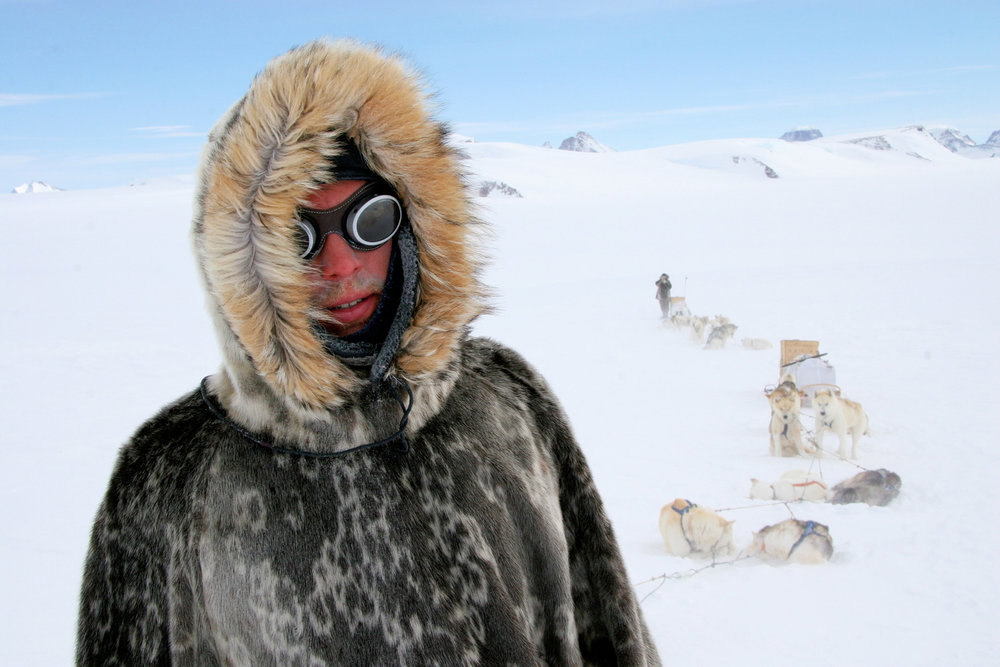 John Huston in a 1911 style anorak on Greenland, as part of the modern Amundsen team, restaging Roald Amudsen's expedition to the South Pole for a BBC/History Channel documentary. © Keo Films/BBC