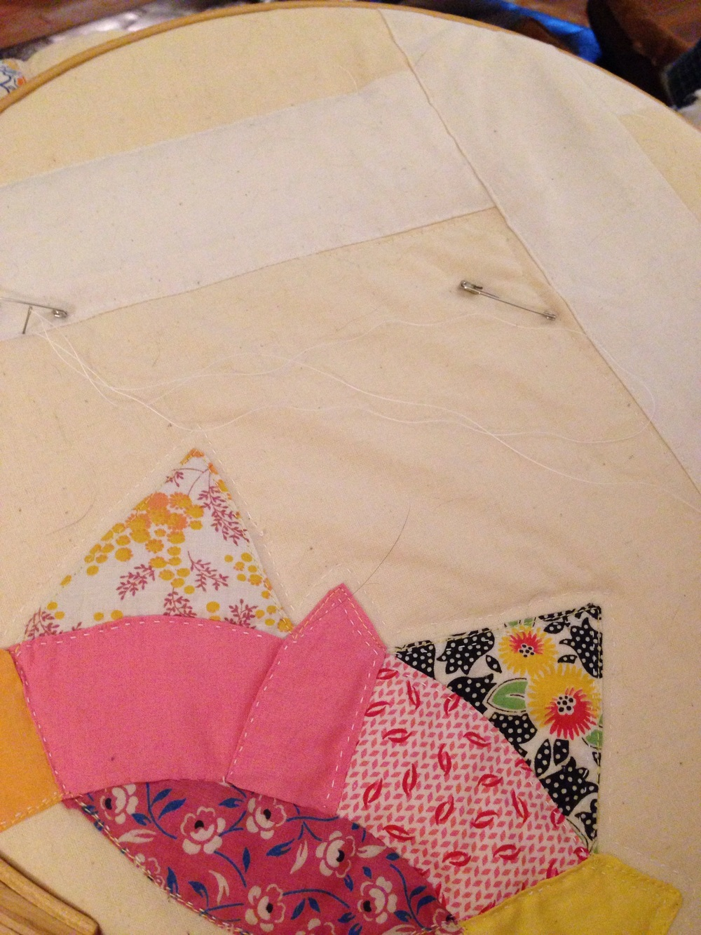 Still deciding which pattern to quilt on the borders.