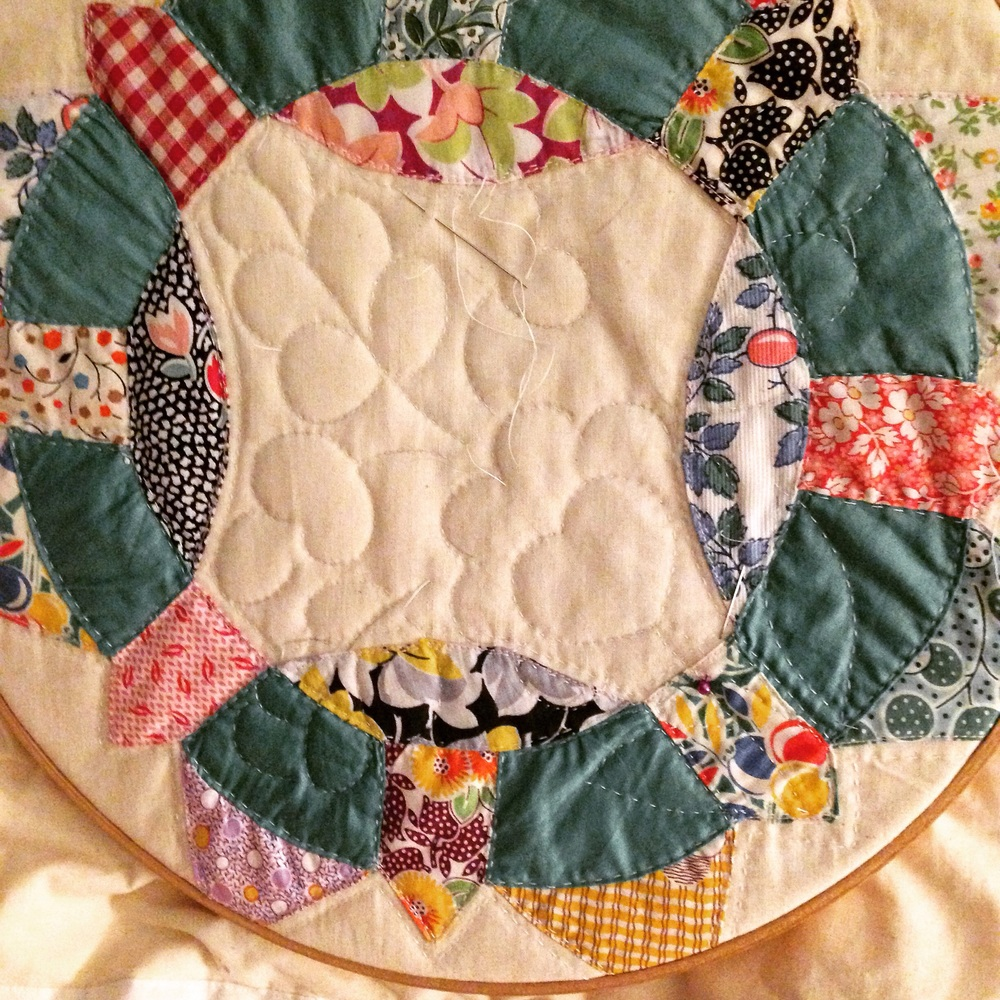 Hand quilting from a stencils.com pattern inspired by handwork from the 1840s.