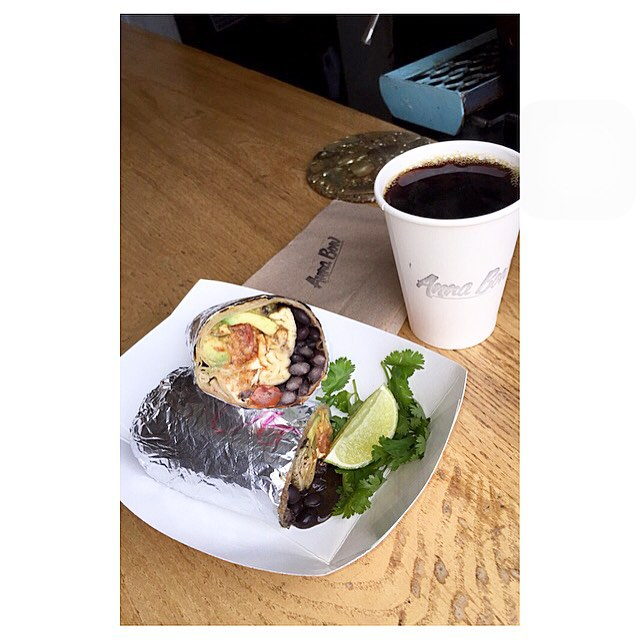 It's what keeps people coming back.  Avocado, egg, cheese, pick de gallo burrito with a hot coffee. $9.  #breakfast #burrito #coffee #rockawaybeach #open