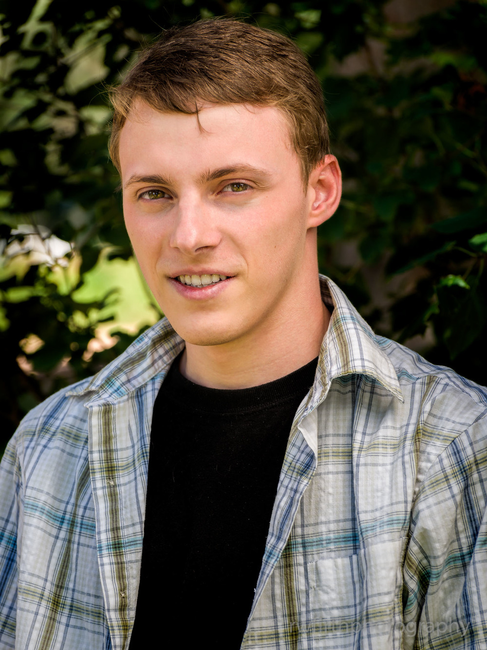 High school senior Tyler during a senior photography session in 2014.  The venue for this session was the City of Colorado Springs demonstration gardens.  Photo by Richard Firth, R.W. Firth Photography.