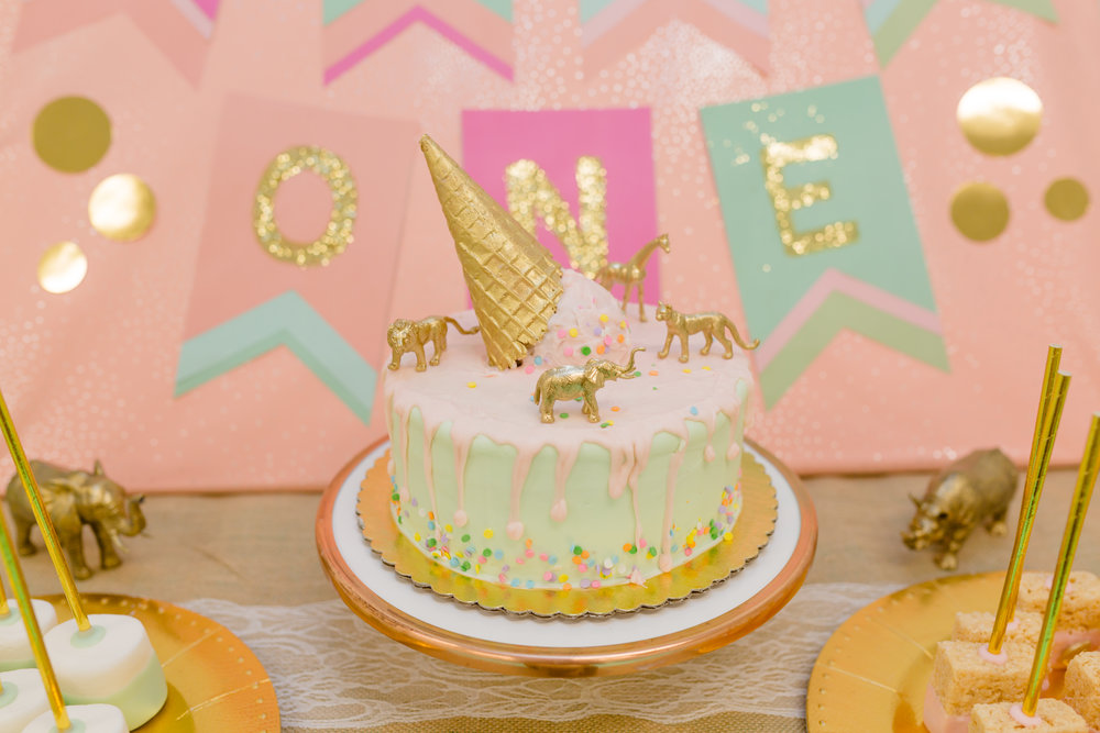 The cake and desserts were made by Ariana of Ari's Sweets. She exceeded my expectations and everything tasted delicious!!! She even painted little gold animals to put on the cake! How cute is that?!