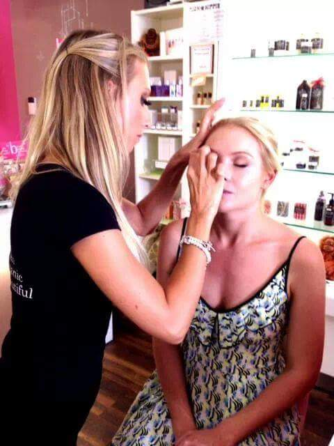applying fake lashes for a client during a professional makeup consultation