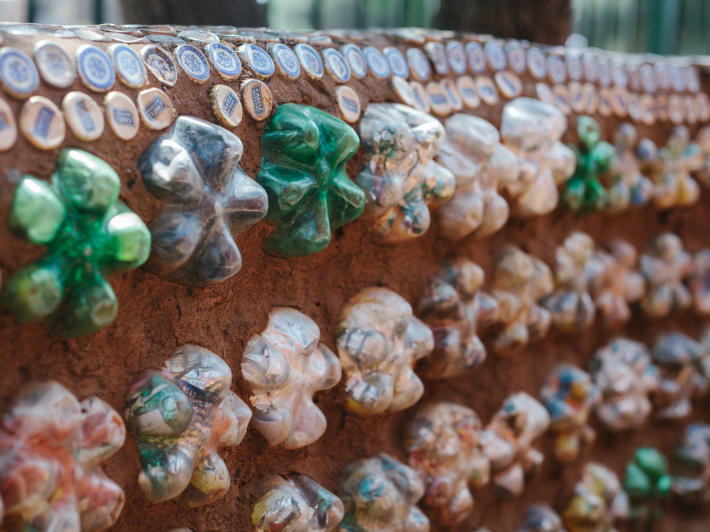 A bench made up of Eco Bricks, which are plastic bottles filled with trash.