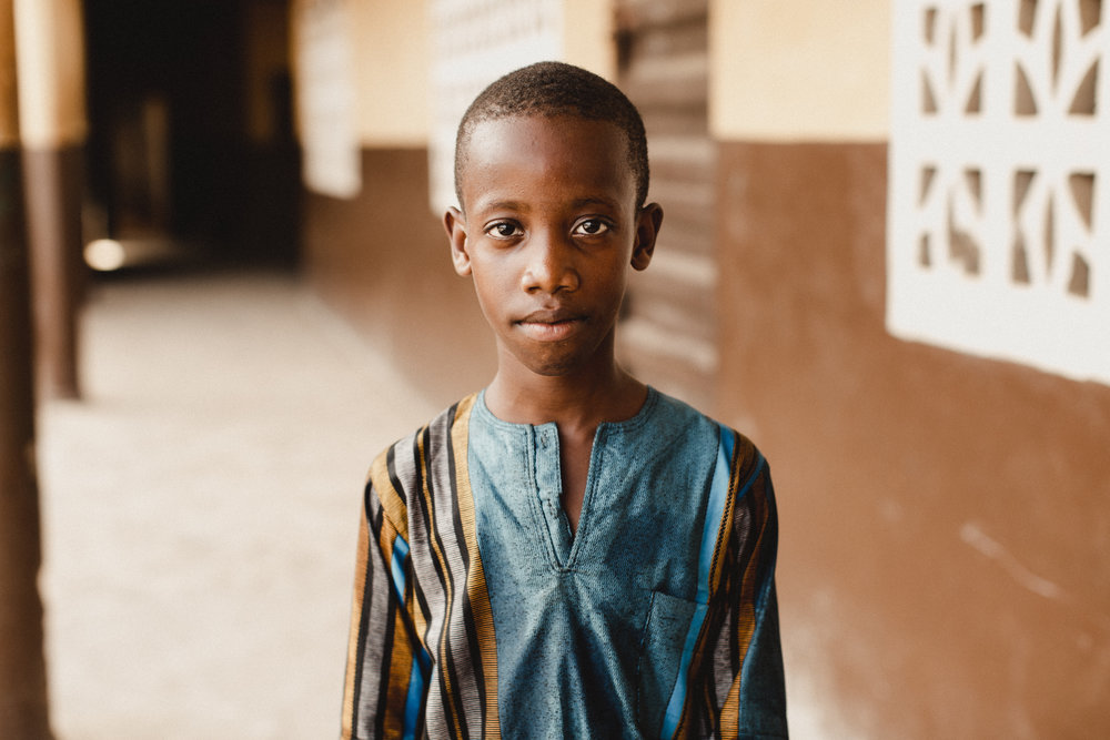 the most precious soul in the most beautiful clothes.my first portrait of the trip. he didn't speak much english, but we exchanged a lot of smiles.
