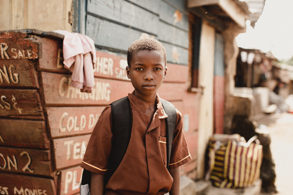 i think this one takes the cake as my favorite portrait taken in sierra leone. as i was walking through the local neighborhood i saw this boy and was so enamored by his beauty that i asked him to stop and wait as i changed my lens to take a photo of him. such a sweet soul with eyes that tell such a grand story. i don't know his name, but he will be my iphone wallpaper for a very long time!