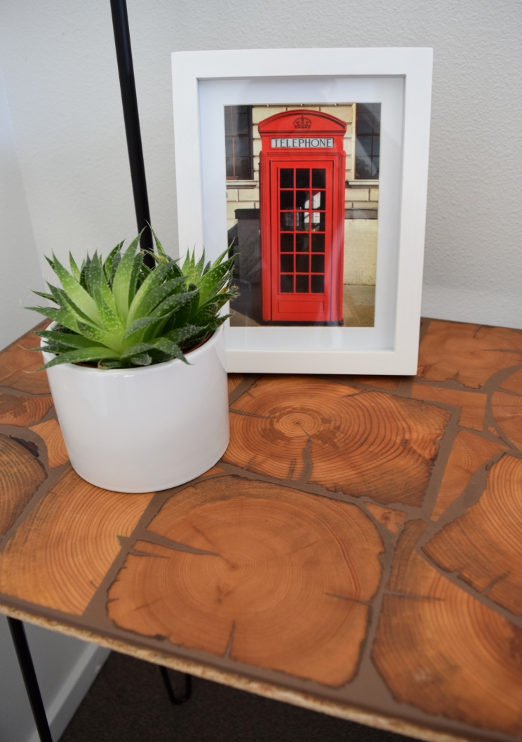 I'm in love with this Floor Tile, and was unsure of how to make it work within the space.  It's actually the perfect size for a side table.  Not only is it visually impressive, it's also practical.  And my framed post card has found the perfect place next to it.
