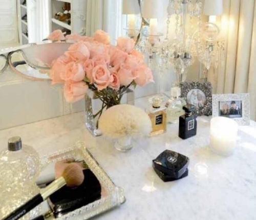 Flowers, perfume, gold and silver trays are perfect items for styling your dressing table.