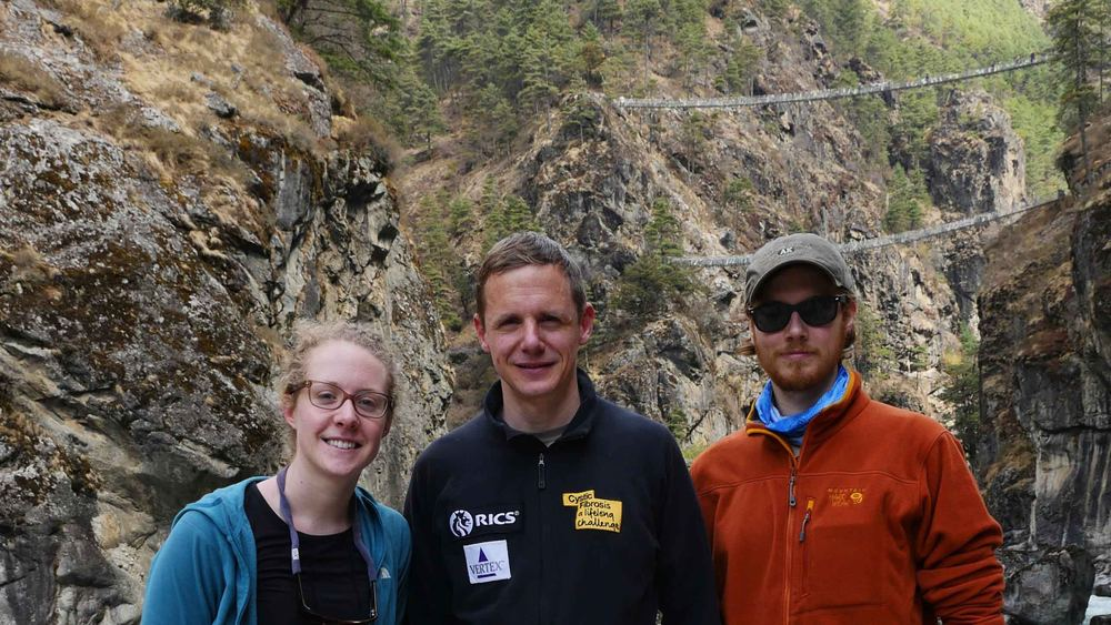 Sierra, Nick, and Mike trekking in Nepal on their way to base camp.