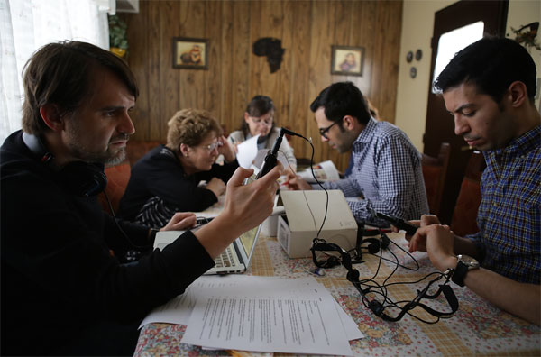 Andries Coetzee, Nicholas Henriksen and Lorenzo Garcia-Amaya, linguistics professors from the University of Michigan, studying the Afrikaans language in Patagonia in Hetta Norval's house. (© Richard Finn Gregory – GOOD WORK)