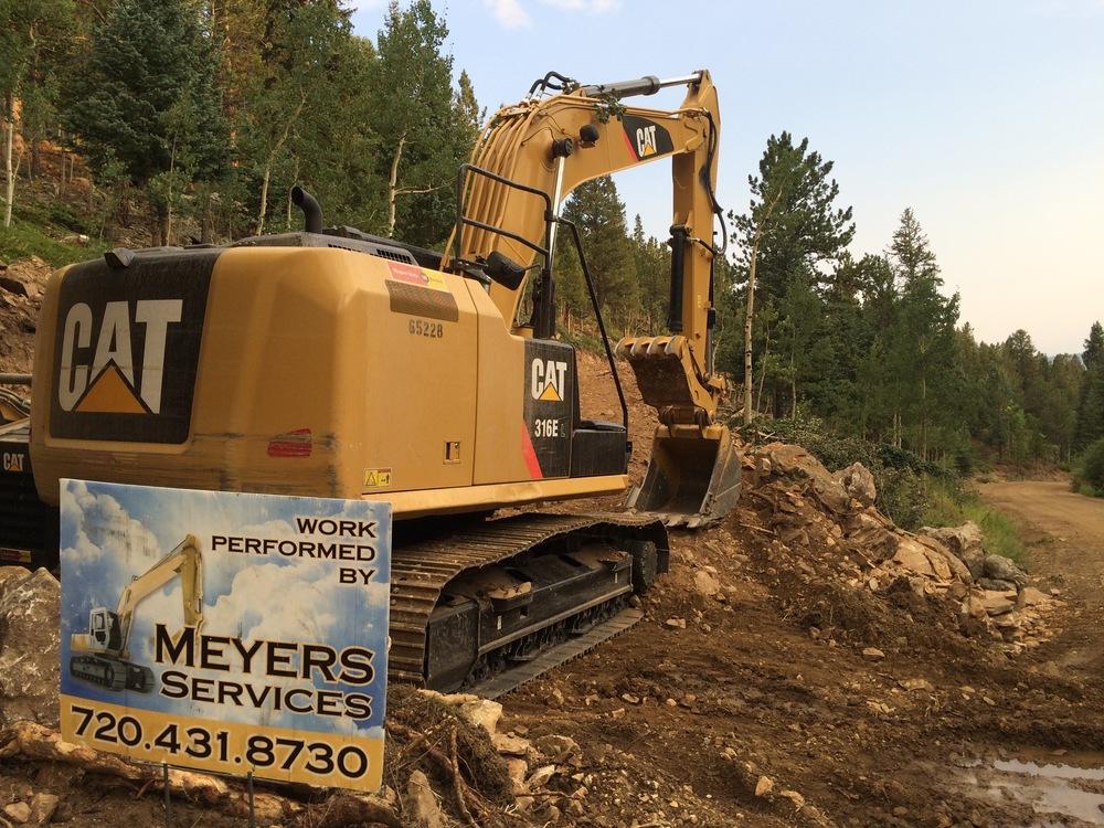 excavator w sign.jpg