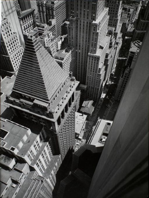 Wall Street from roof of Irving Trust Co Building in Manhattan in 1938   By Abbott, Berenice [Public domain], via Wikimedia Commons