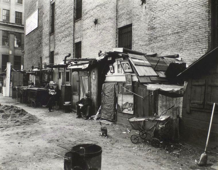 Huts and unemployed in West Houston and Mercer St in Manhattan in 1935   By Berenice Abbott [Public domain], via Wikimedia Commons
