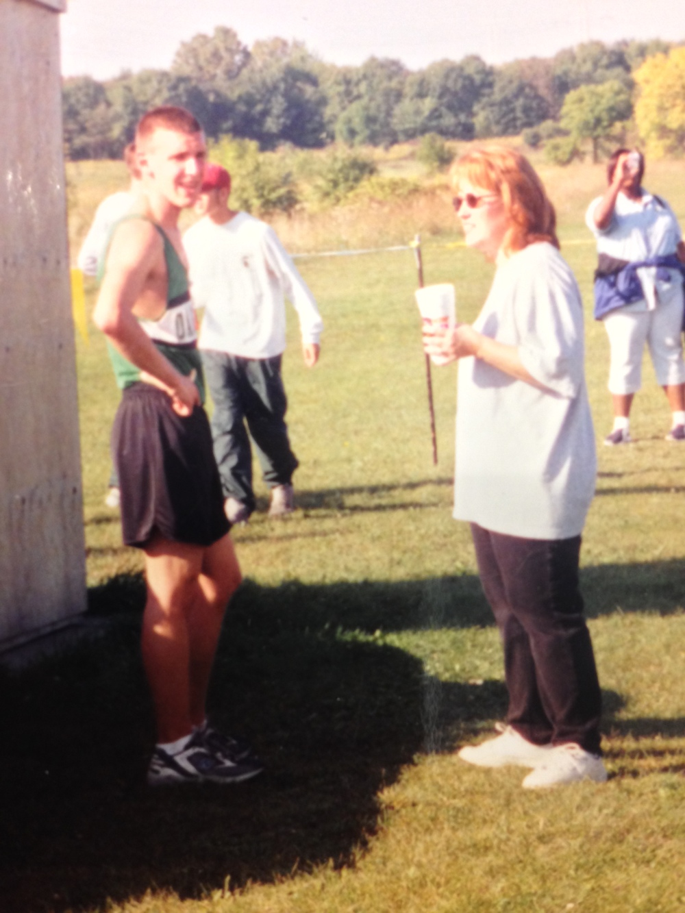 Wendy, cheering me on in HS. This was before I actually liked to run.