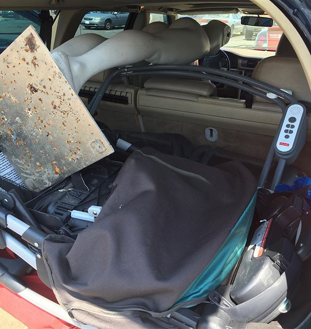 Contents of my car on any given day-stroller, rock and play, antique mannequin missing its arms......normal stuff
