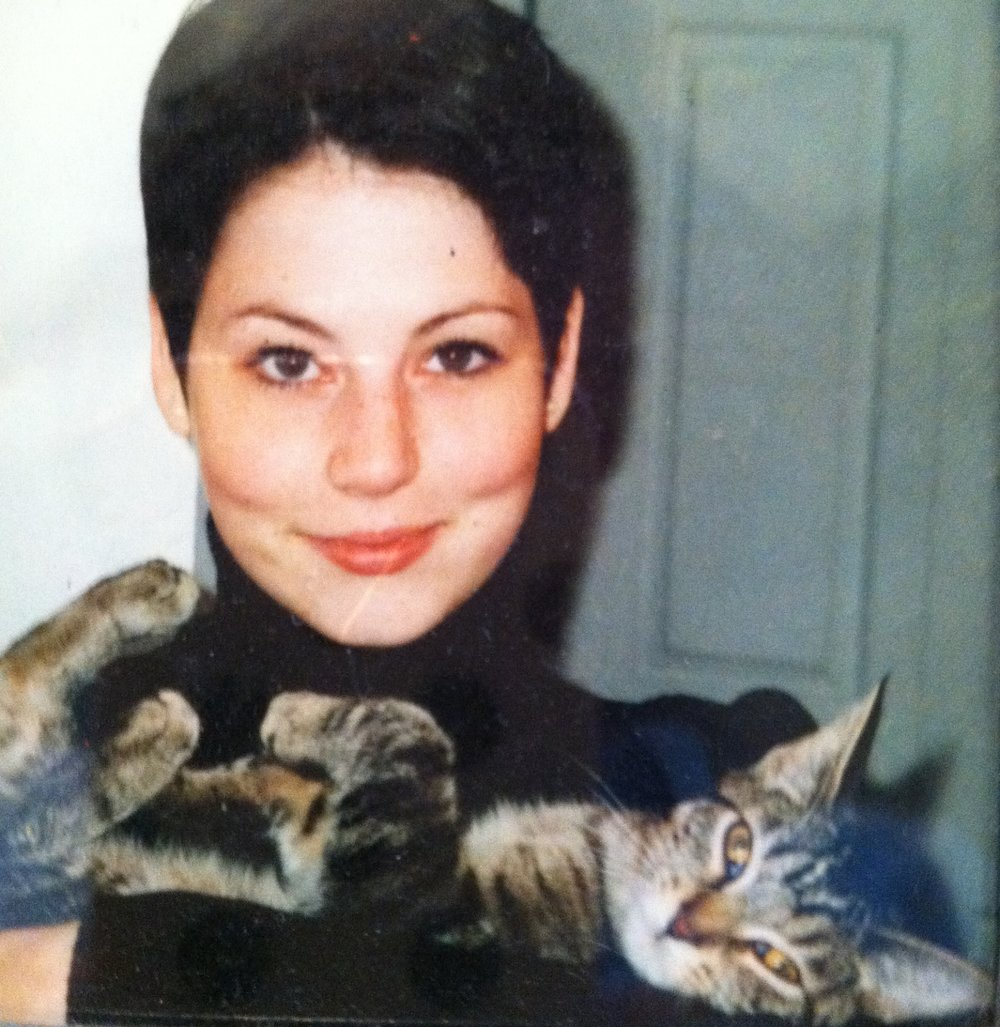 A photo from Ginny's college days with a feline family member.