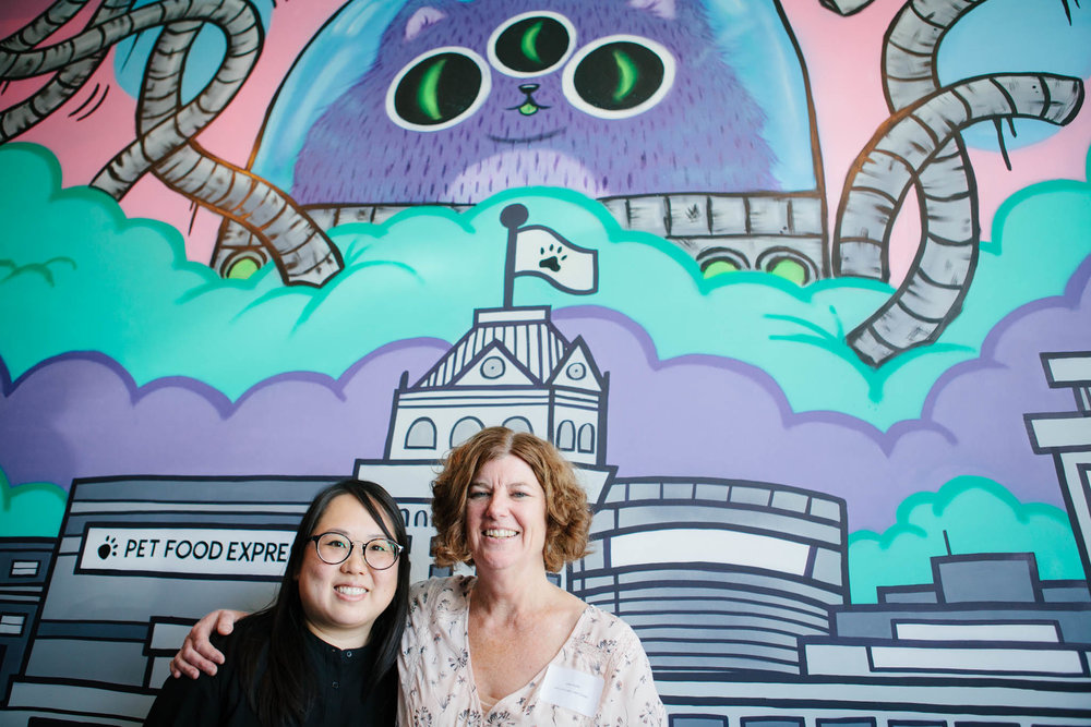 Michelle (left) and Ann pose at our mural reveal party on April 7th. Photo by Scott Russell.