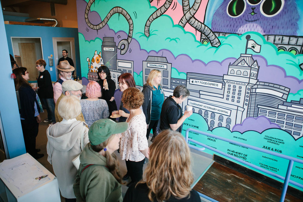 Donors gather for the mural reveal party at Cat Town on April 7th. Photo by Scott Russell.