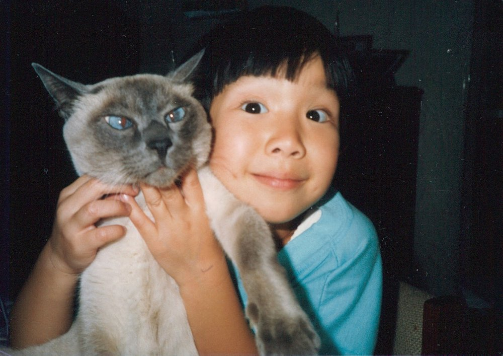 Angeline with her first cat, Smokey.