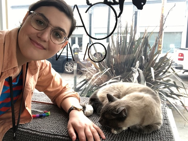 Nicole on her volunteer shift at Cat Town with Nova.