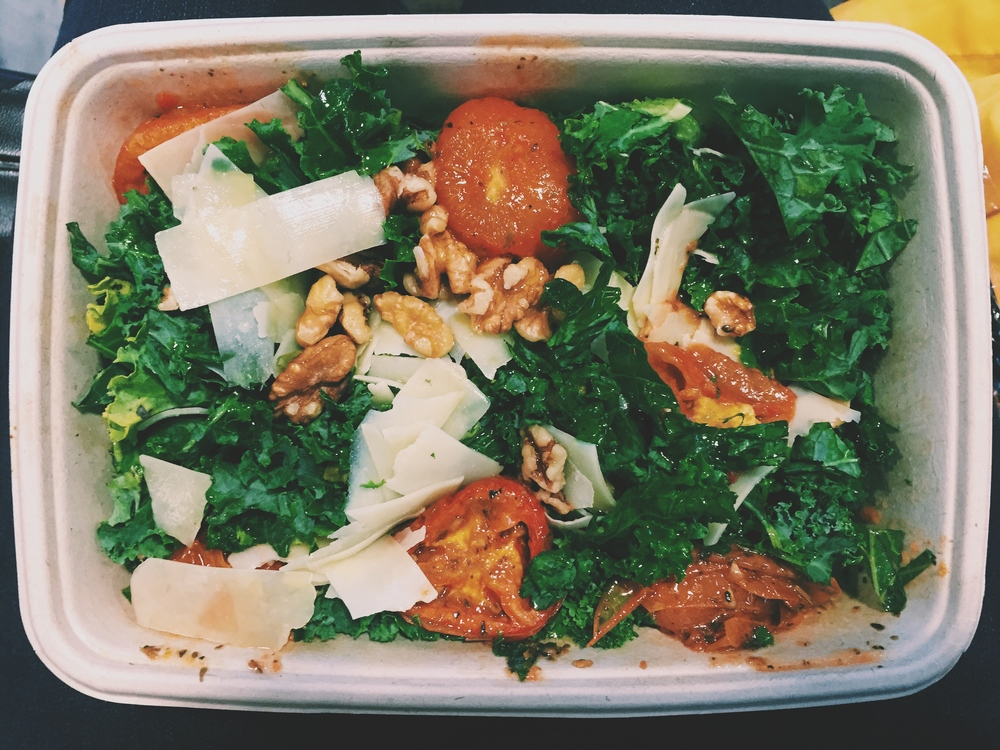 Kale and roasted tomato salad with walnuts and shaved freshparmesan (no dressing, the tomato's had olive oil on them) from Taylor in the Washington DC Reagan Airport