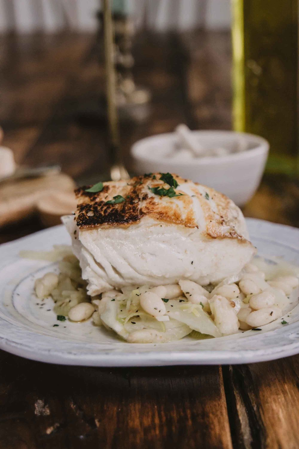 Pan Seared Halibut Recipe With Garlic Cannellini Beans And Fennel