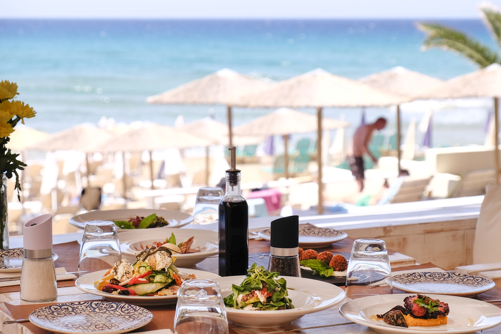 the mediterranean table set beachside in corfu at nagual