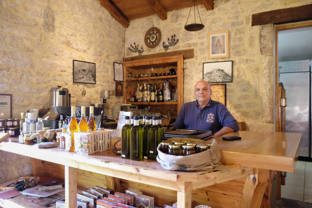 a local business sells organic and homemade food and drinks like honey and oil in palea perithia old perithia corfu