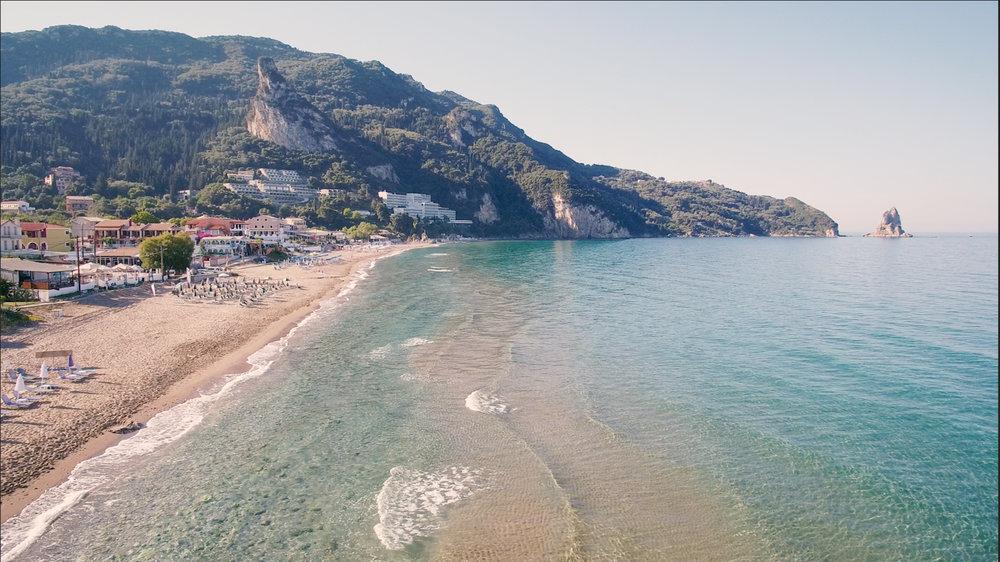 drone still of coastal road in Agios gordios, corfu