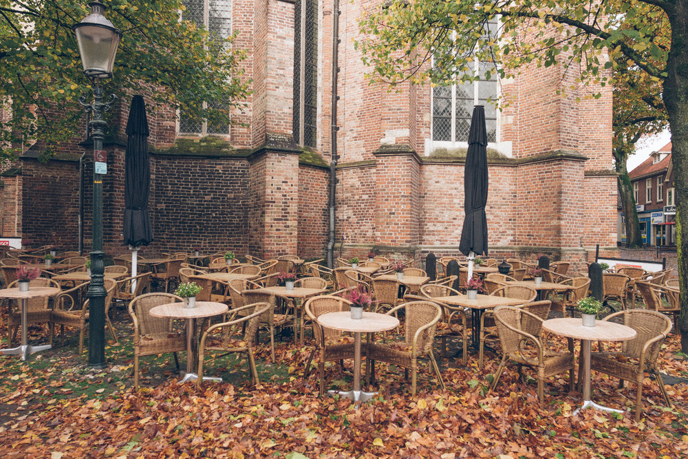 A local cafe patio at the base of the old church
