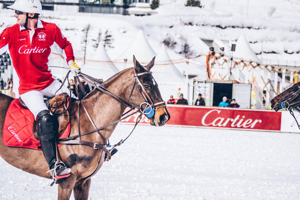 a member of the Cartier snow polo team with his pony