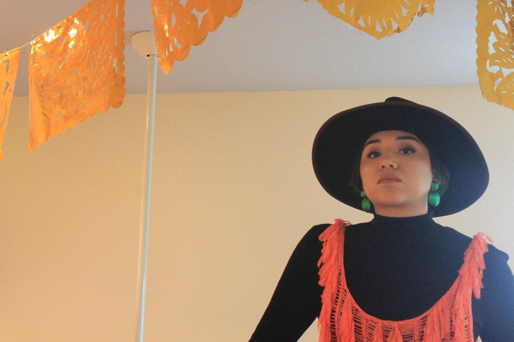 Andie Flores in her home in Austin's Rosewood neighborhood. (Photo: Jason Ikpatt   @jvsonikpvtt)