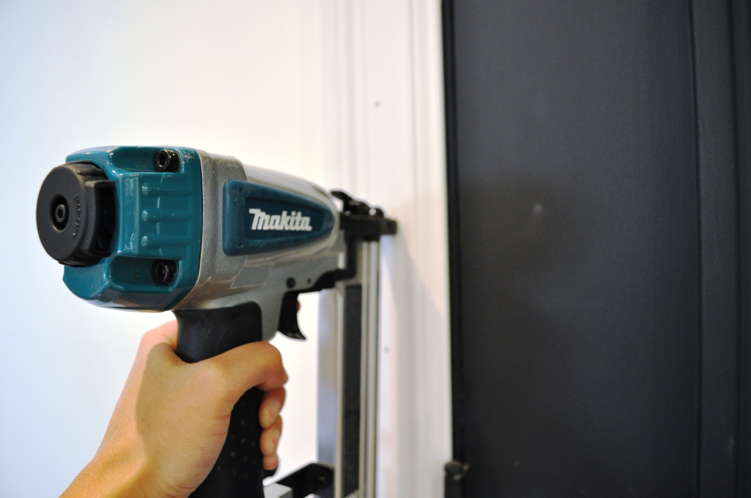 Using a Nail Gun to affix molding to the wall