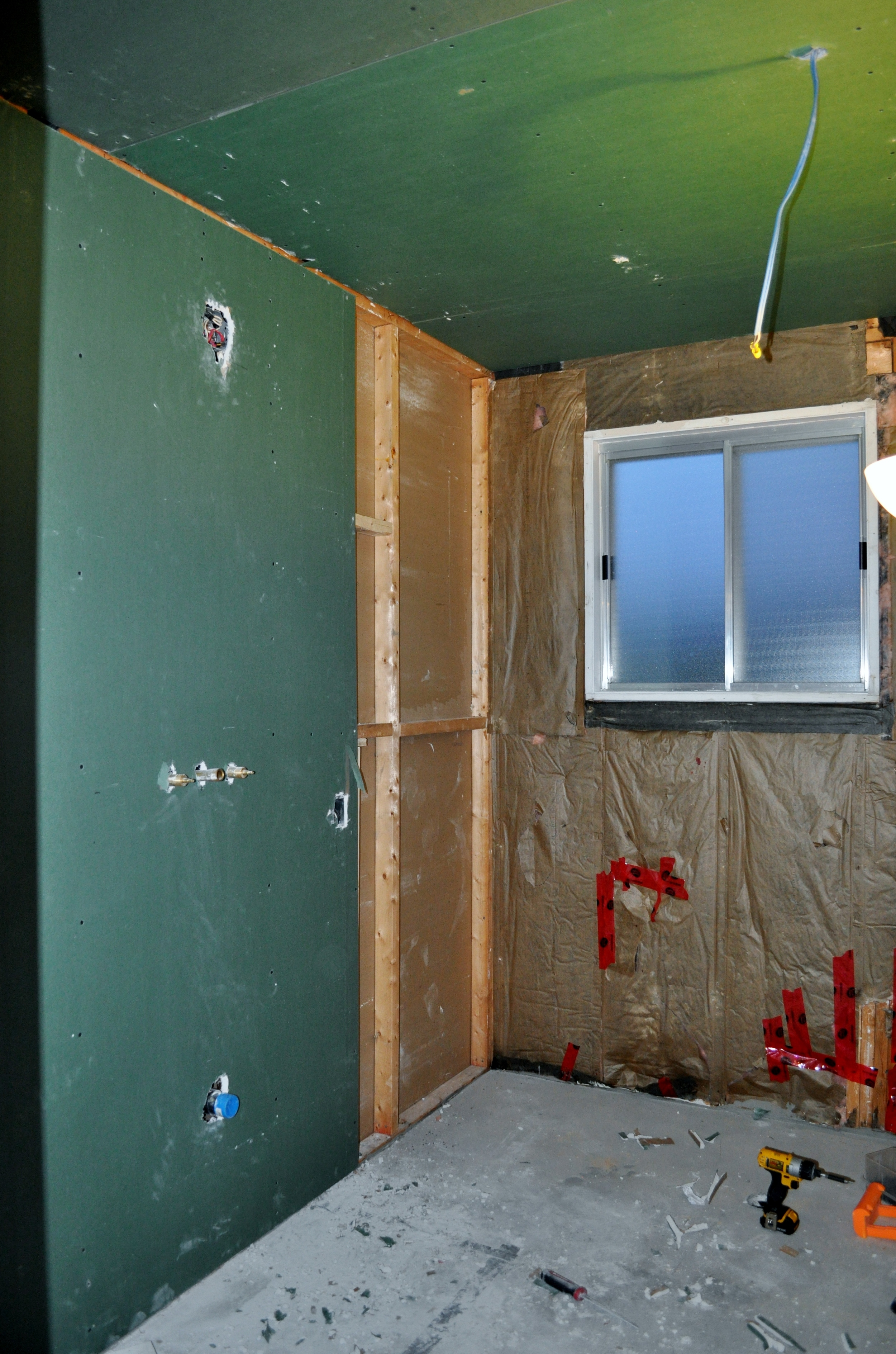 Bathroom drywall  being installed