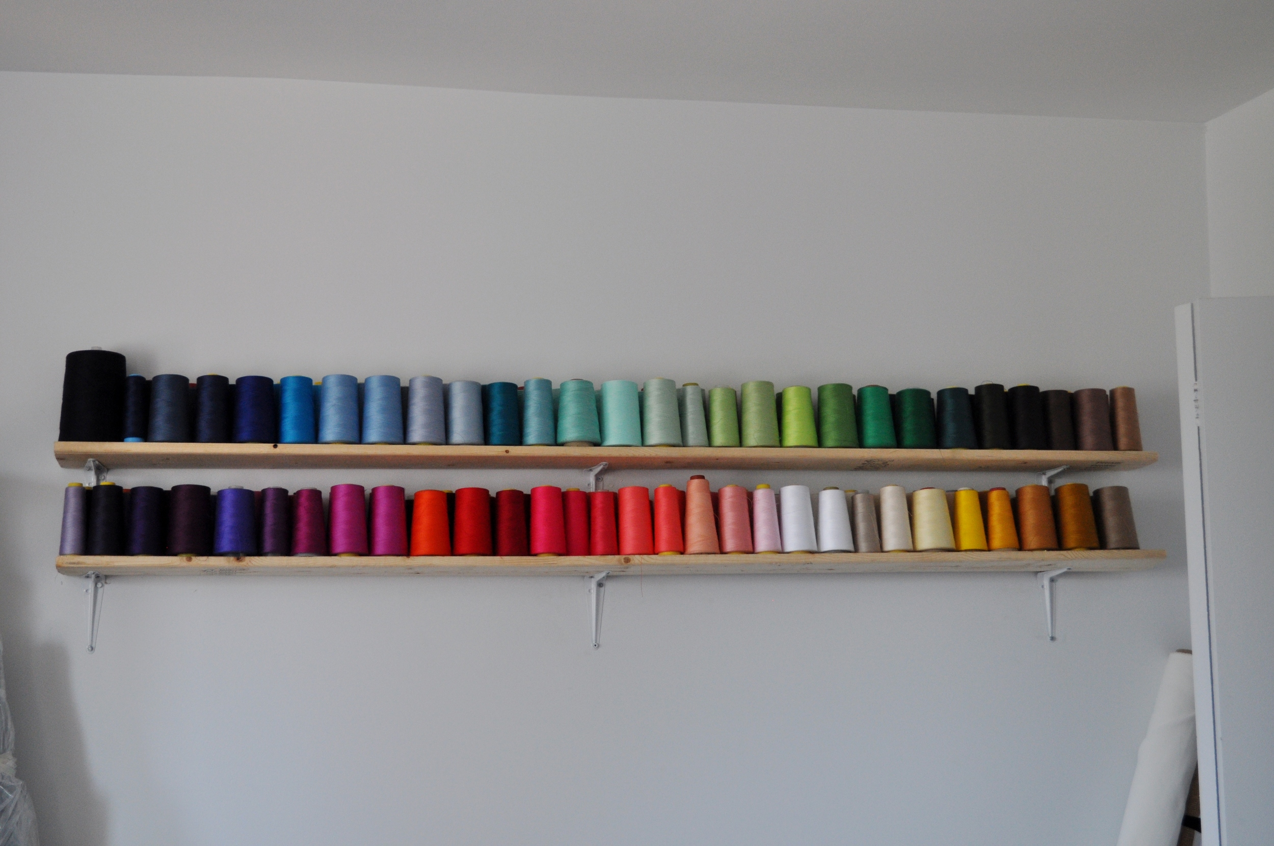 Colored Spools on shelves