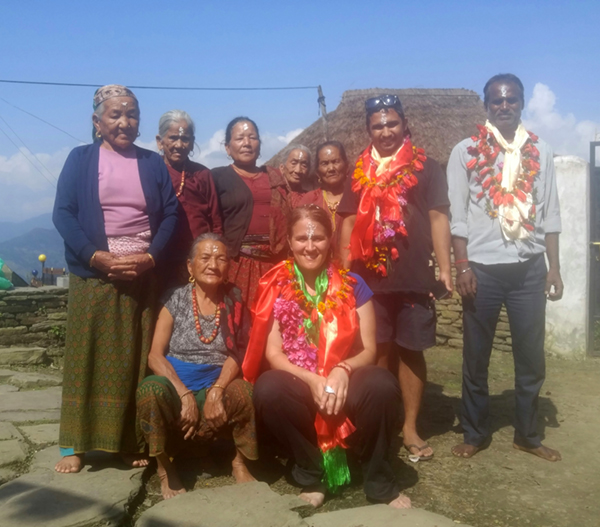 The day that Bibek and I arrived in the village together, with the elders of the village and our contractor. There is a tradition of offering scarves and flower garlands to special guests.