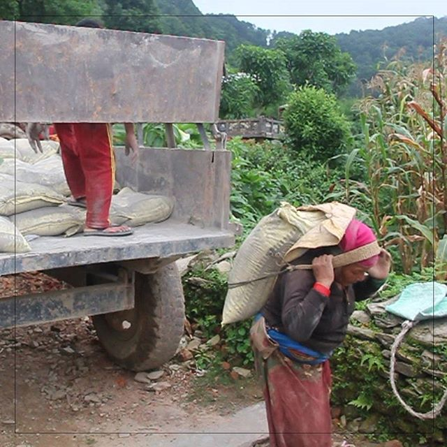 The villagers are full contributors to our rebuilding efforts. They made a financial investment in their homes. They are also responsible for things such as unloading the cement delivery.  Bittikumari Gurung is shown bringing cement from her truck to the village while her son unloads the delivery.