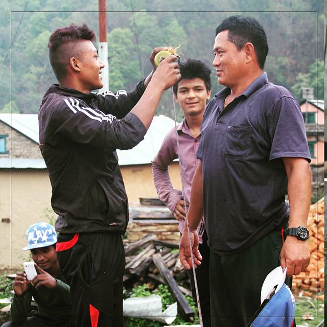 Shambhu Gurung, right, resident of Rainaskot, jokes with the workers that constructed the homes.  Shambhu became very knowledgeable about the process of making the homes earthquake-safe. He speaks about it in the short film that is currently being prepared about the process of rebuilding Rainaskot.