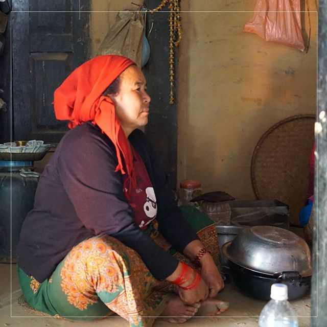 In a photo taken prior to rebuilding, Ram Pyari sits in her kitchen, cooking up a pot of the local brew.  With her husband in Saudi Arabia working as a laborer, it's up to her to keep all of housework. In addition to cooking and cleaning, she tends the animals and farming.