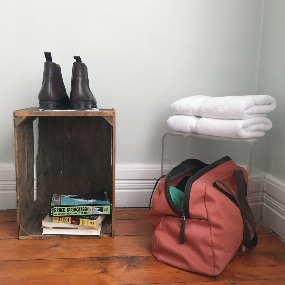 Chelsea Boots by Jack Erwin; Weekender Bag by Everlane
