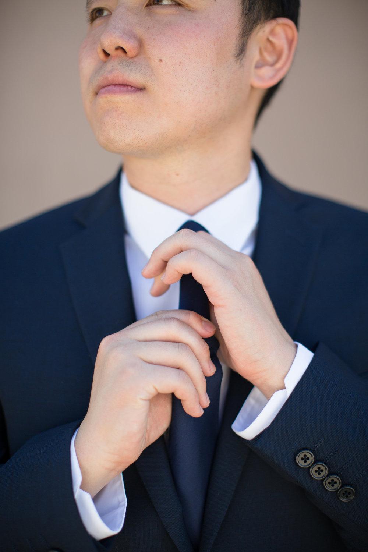 John fixes Tie