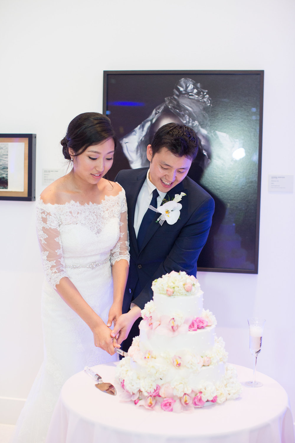 The happy newly-weds cutting the cake and toasting to a happy marriage! Photo by  France Photographers