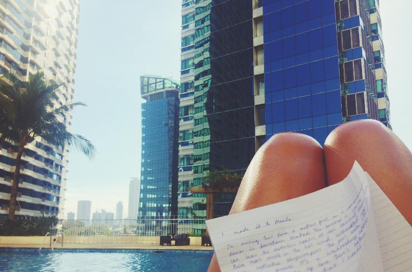 Roof top swimming pool. Legs tanning. Manila, Makati, Rockwell.