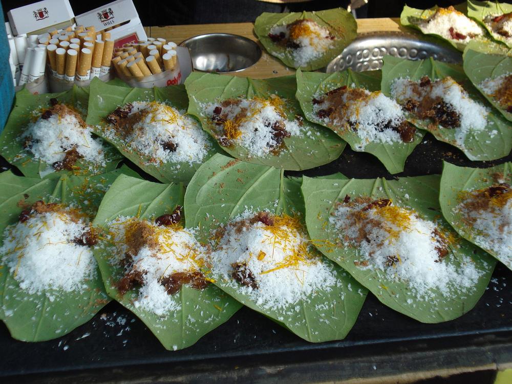 Banarasi Paan betel nuts arranged on betel leaves. Credit: Flickriver