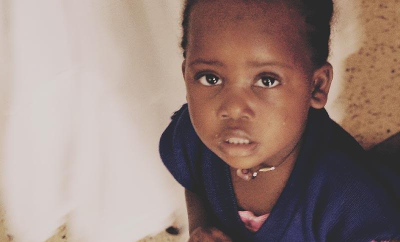 Uganda Kisembo staring up at the camera.jpg