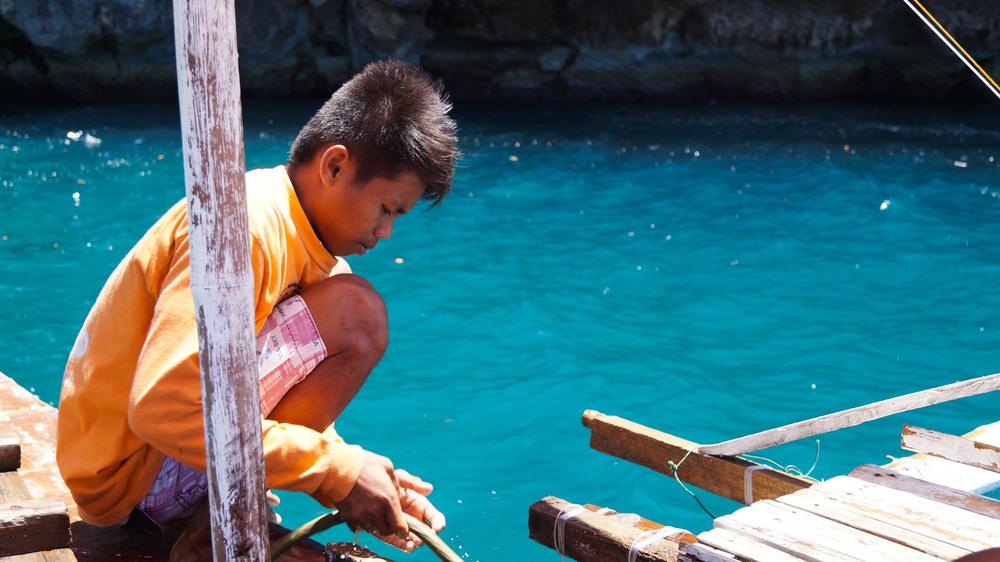 Islas de Gigantes - Local kid on bangka - Philippines - illumelation